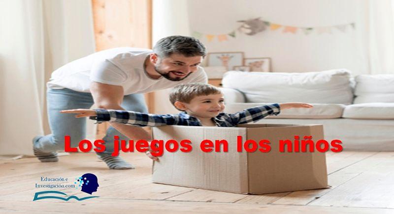 Los Juegos en los niños, Padre empujando a su hijo en un cartón, recreando un juego